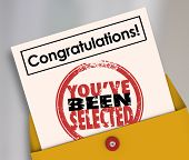 Congratulations You've Been Selected words on an official letter or notification in an envelope to a