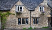 WILTSHIRE, CHIPPENHAM, UK - AUGUST 9, 2014: Old house in Castle Combe village