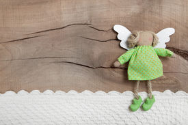 picture of christmas angel  - Top view of angel with crochet strip on wooden background for christmas  - JPG
