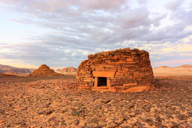 picture of empty tomb  - Ancient tombs in the desert glow orange in the late evening sun - JPG