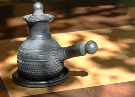 pic of loamy  - Arabian style coffee pot on wooden table - JPG
