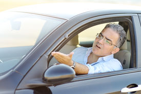 image of irritated  - irritated male driving his car in traffic  - JPG