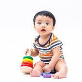 picture of non-toxic  - Cute asian baby playing toy isolated on white - JPG