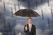 stock photo of stressless  - relax businessman protected against stress rain by an umbrella - JPG