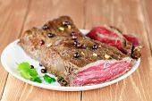Delicious dinner of rare roast beef