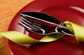 picture of marsala  - simple table setting with green ribbon and marsala plate - JPG