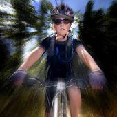 Young Woman Riding Mountain Bike in Wilderness
