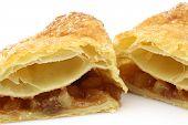 Freshly baked crispy apple turnover halves