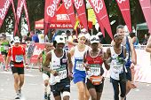 Male And Female Participants Running In The 2014 Comrades Marathon