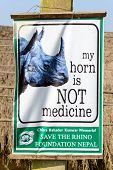 SAURAHA, NEPAL - 23 DECEMBER 2014: A board from Save the Rhino Foundation Nepal reads 'my horn is NOT medecine'. The rhino is an endangered species.