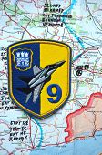 Illustrative editorial.Chevron of Ukrainian air force. 9 Aviation brigade.Estern Ukraine map with site MH-17 flight crush as background. At January 10,2015 in Kiev, Ukraine