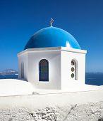 Church With Blue Cupola At Oia Village, Santorini Island.