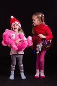 Two Girls In Christmas Clothes Grimace