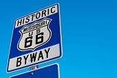 Historic route 66 highway signs in Missouri USA. Blue sky background