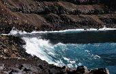 Waves Crashing Aginst Cliff