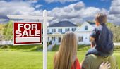 picture of yard sale  - Curious Family Facing For Sale Real Estate Sign and Beautiful New House - JPG