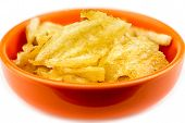 Thick Rippled Potato Chips In Bowl Isolated