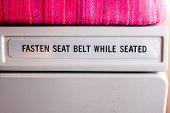 Text description backside airplane seat