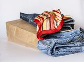 Shopping: jeans of various shades in paper packages