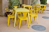 Yellow Tables And Chairs At Outdoor Restaurant