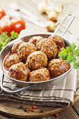 foto of meatball  - Meatballs in tomato sauce in the pan - JPG