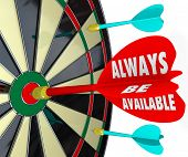 Always Be Available words on a dart hitting the bull's eye or target on a board to illustrate the success of being accessible and having convenient service for customers and contacts
