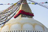 Boudhanath stupa - the symbol of Nepal, with colorful prayer flags in the background.