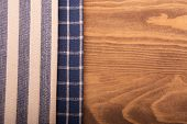 Blue and off white kitchen towels on wooden table