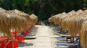 Straw parasols (umbrellas) on Ag Saranta Beach. Pelio, Greece