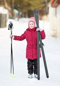 child engaged in skiing to the winter