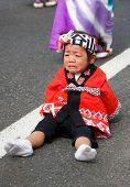 Young child crying at a Japanese Dance Festival