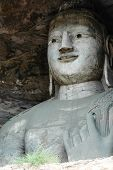 stock photo of grotto  - A spectacular Bodhisattva sitting in a huge cave in Yungang grotto - JPG