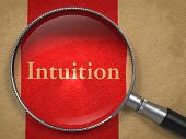 picture of intuition  - Intuition through Magnifying Glass on Old Paper with Red Vertical Line - JPG