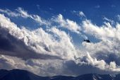 Helicopter In Cloudy Sky