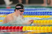 GRAZ, AUSTRIA - APRIL 05, 2014: Laurent Carnol (Luxembourg) places 3rd in the men's 200m breaststroke event in an indoor swimming meeting.