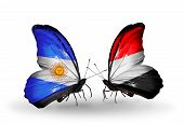 Two Butterflies With Flags On Wings As Symbol Of Relations Argentina And  Yemen