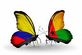 Two Butterflies With Flags On Wings As Symbol Of Relations Columbia And Guinea Bissau