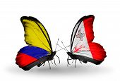 Two butterflies with flags on wings as symbol of relations Columbia and Malta