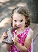 Little Girl Eating A Chocolate Bunny