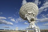 Radio Telescopes in Field on Sunny Day