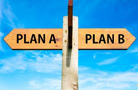 stock photo of opposites  - Wooden signpost with two opposite arrows over clear blue sky Plan A and Plan B Right choice conceptual image - JPG