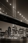 stock photo of tribute  - New York City downtown Brooklyn Bridge and september 11 tribute at night - JPG