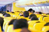 stock photo of air hostess  - Aisle inside a plane - JPG