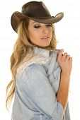 pic of cowgirls  - a cowgirl with her western hat on playing with her shirt - JPG