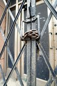 picture of lock  - Photograph of security gate locked with chain and pad lock - JPG
