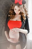 foto of hair bow  - Young beautiful pregnant woman - JPG