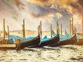 picture of gondola  - beautiful gondolas in a canal in Venice at sunset - JPG