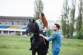 image of appaloosa  - pair of lovers walk with a horse - JPG