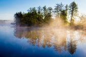 image of calming  - Morning fog on a calm river - JPG