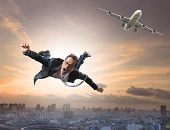 picture of top-secret  - crazy business man flying from passenger plane with glad and happiness emotion use for new trend people traveling and top secret strategy - JPG